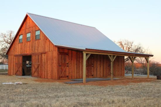 Photos of pole barns with 16 doors and living quarters for Custom rustic homes