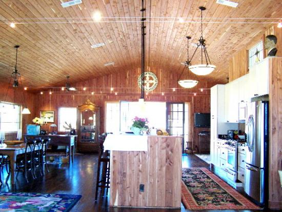 Interior Open Floor Plan In A Gable Barn Home With 3 Car Garage Below